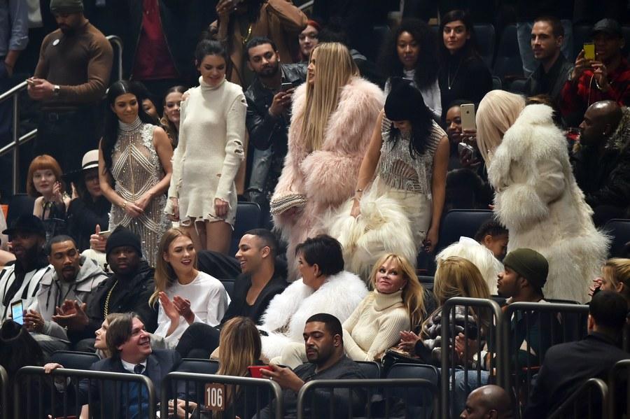 Mandatory Credit: Photo by Andrew H. Walker/WWD/REX/Shutterstock (5585909at) 50 Cent, Karlie Kloss, Olivier Rousteing, Melanie Griffith, Kourtney Kardashian, Kendall Jenner, Khloe Kardashian, Kylie Jenner and Kim Kardashian in the front row Yeezy show, Runway, Fall Winter 2016, New York Fashion Week, America - 11 Feb 2016